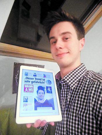 """<p class=""""caption"""">Niklas mit dem E-Paper am Tablet.</p>"""