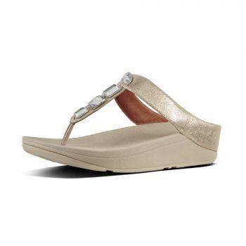 """<p class=""""caption"""">Wirkt elegant und absolut stylisch, Fußverwöhner: FitFlop Roka™ Silver.</p>"""