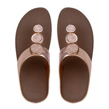 """<p class=""""caption"""">Zartschimmernd in Pastell:</p><p class=""""caption"""">FitFlop Halo™ Rose Gold.</p>"""