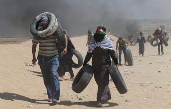 Palästinensische Demonstranten am Gazastreifen.Fotos: APA