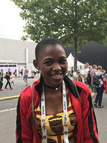 """<p class=""""title"""">               Christine, 16, Malawi             </p><p class=""""title"""">Die Gymnaestrada ist ein Ort, an dem wir unsere Farben und Talente zeigen können. Außerdem können wir unsere Ideen und Ansichten mit anderen Menschen teilen. Wir sind seit Samstag hier und haben in dieser Zeit schon unterschiedliche Dinge gesehen. Wir lieben es, die Umgebung zu erkunden und suchen auf unserer Reise nach neuen Freunden. Wenn wir von der Gymnaestrada nach Hause kommen, können wir das Gesehene und Erlebte als Erfahrung nutzen.</p>"""