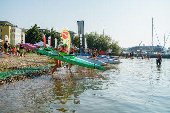 """<p class=""""caption"""">Wer kommt am schnellsten ins Wasser und aufs SUP? Bei den Wettbewerben entschied jedes Detail über Sieg oder Niederlage.</p>"""