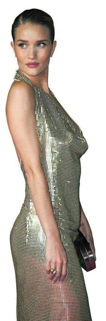 London. Glitzernd: Model Rosie Huntington-Whiteley erscheint bei den British Fashion Awards in der Hauptstadt. Fotos: AP, Invision, APA, AFP, Reuters,