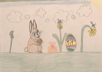 """<p class=""""caption"""">Mias Osterhase versteckt die Eier.</p>"""