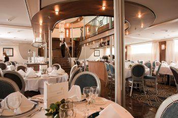 """<p class=""""caption"""">Das Hotelschiff MS ALINA bietet eine feine Küche und besten Komfort.</p>"""