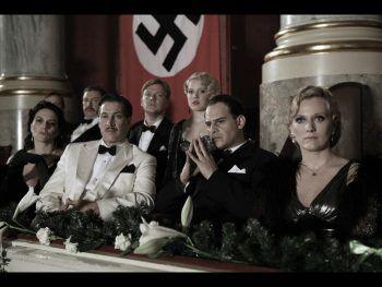 """<p class=""""caption"""">Lena Reichmuth (re.) als """"Magda Goebbels"""" in """"Jud Süss – Film ohne Gewissen"""". Neben ihr (v.l.): Martina Gedeck, Tobias Moretti und Moritz Bleibtreu.</p>"""